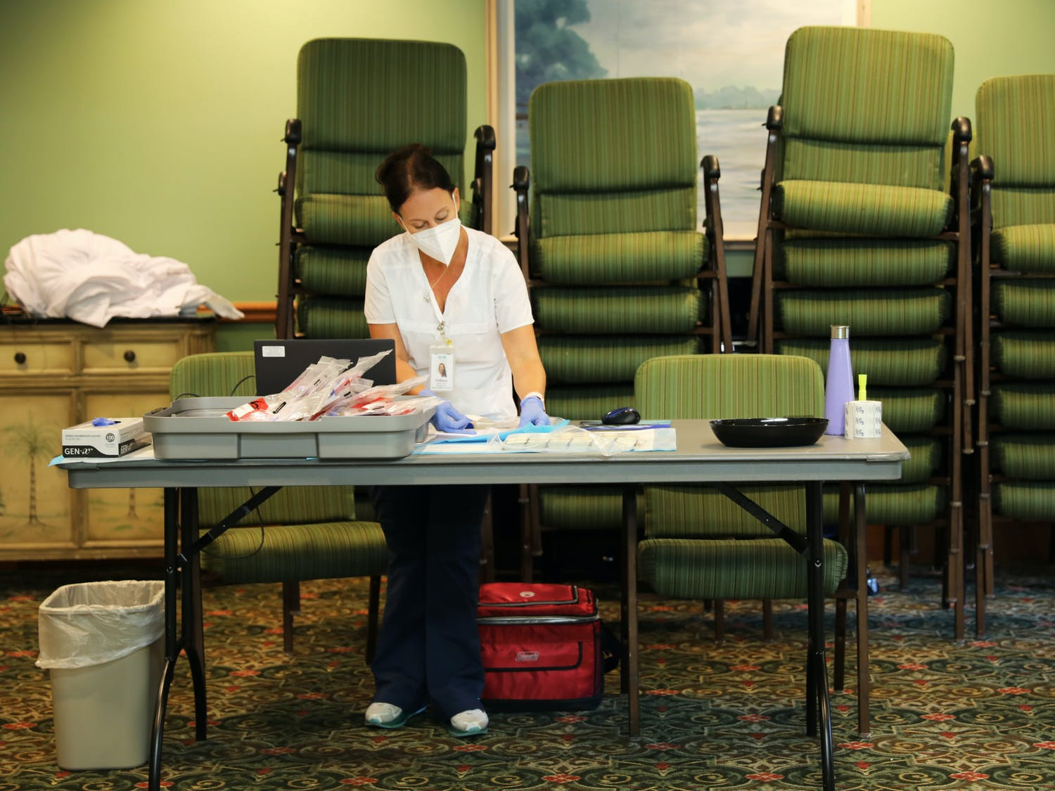 Tiffany Bach, the manager of the CITRUS Study, arranges files after collecting blood samples on Wednesday, June 9, 2021.