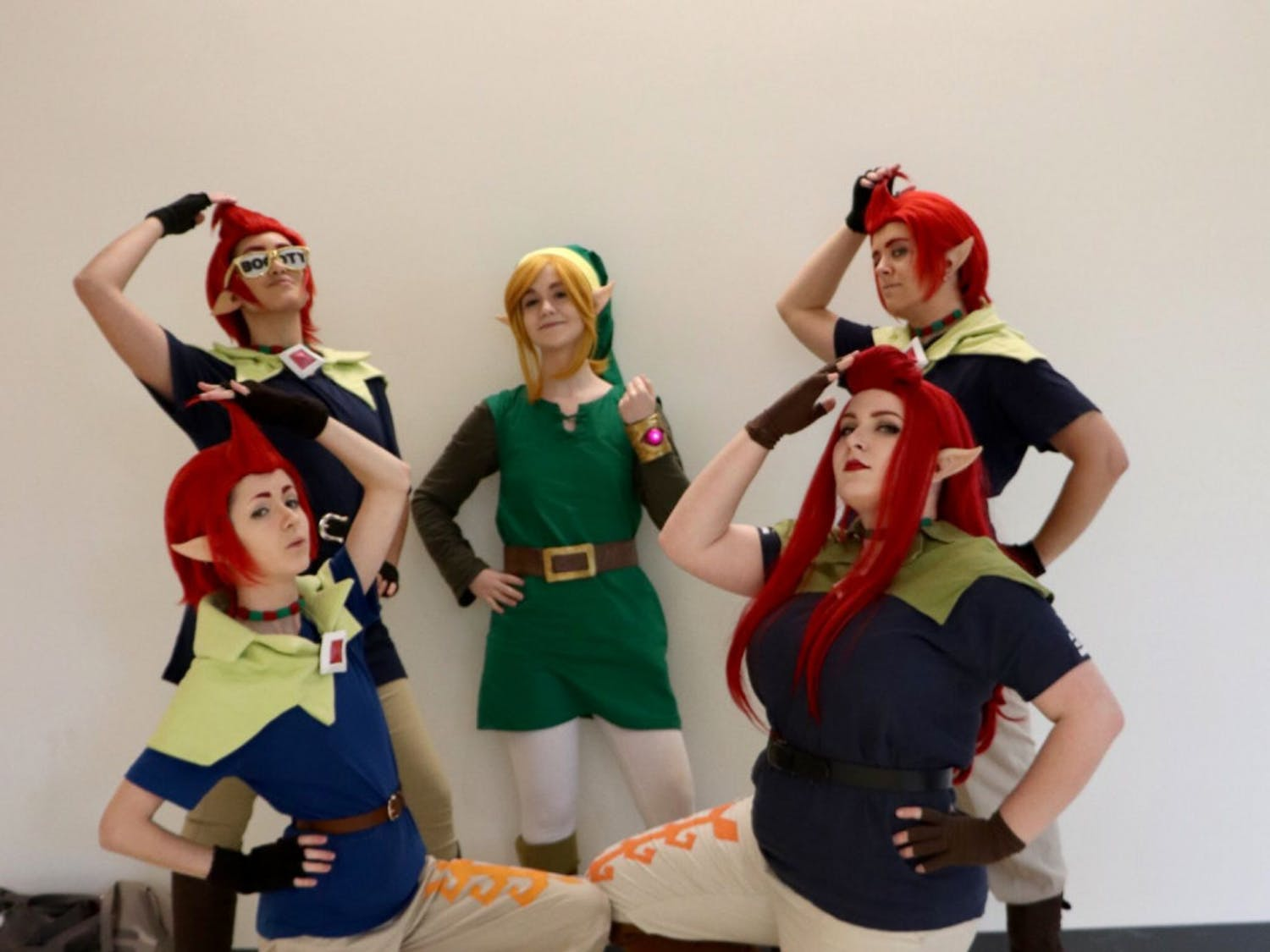 "Link and the Groose Flock Left to Right Names: Maddie Langguth, Kim Cruz, Katrina Lundquist , Keira McDonald and Kaitlin Duggan. The five planned this group cosplay a year in advance as an inside joke. Lundquist cosplays as Link, a character from ""The Legend of Zelda"" series, and the remaining four ladies dress up as Groose, who appears in ""The Legend of Zelda: Skyward Sword."" According to Duggan, the group spent three hours working on their costumes in their hotel room. They have attended multiple conventions as Link and the Groose Flock. ""It's nice we're a joke cosplay every once in a while,"" said Duggan. The group advises first-time cosplayers to have fun and to plan ahead. ""Start early,"" said McDonald. ""Do not 'con crunch' and don't start your cosplay in three hours possibly in a hotel room."""