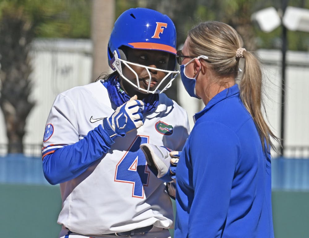 <p>UF third-baseman Charla Echols in conversation with a base coach. Echols notched an RBI-double Wednesday. </p>