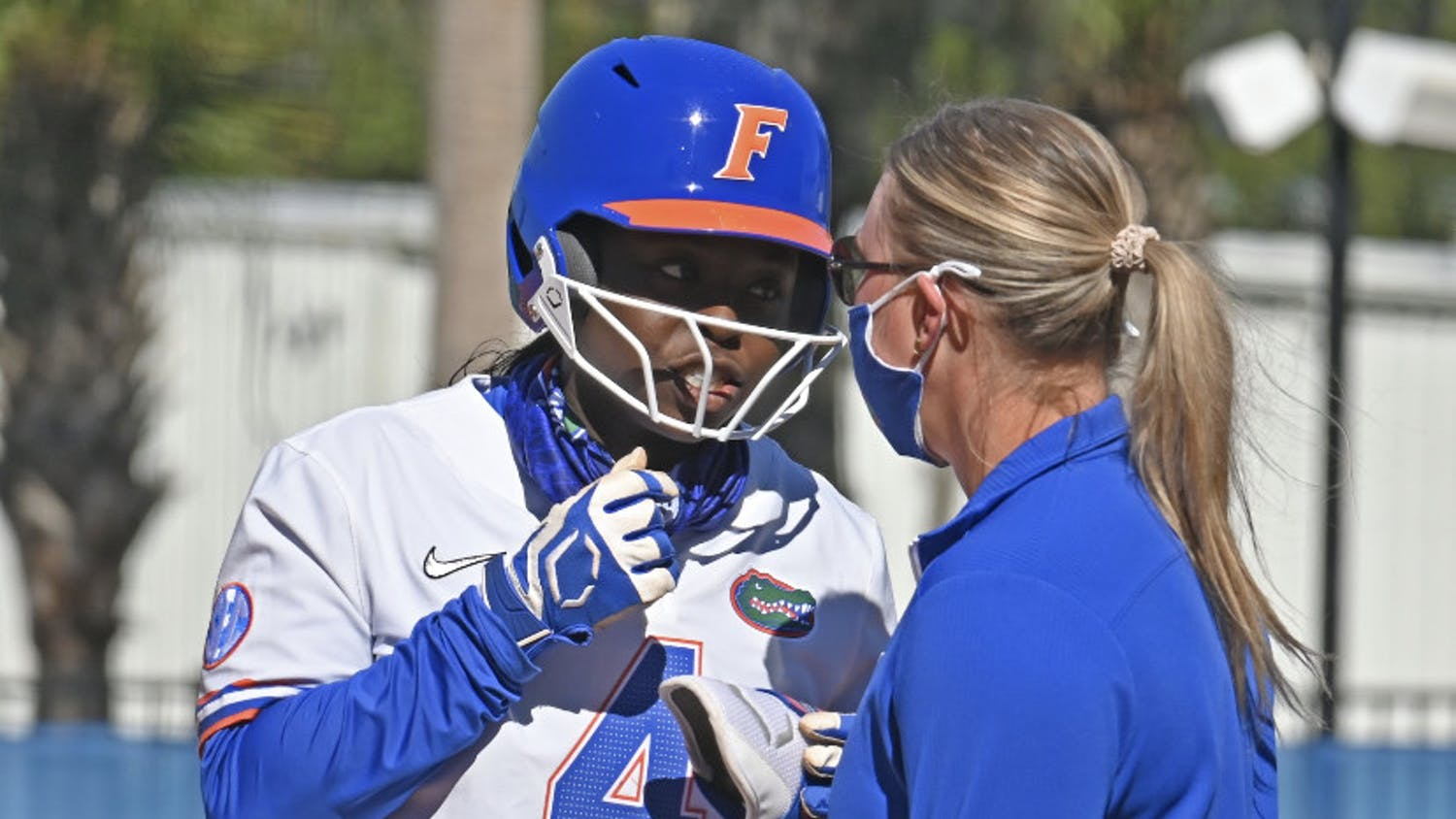 UF third-baseman Charla Echols in conversation with a base coach. Echols notched an RBI-double Wednesday.