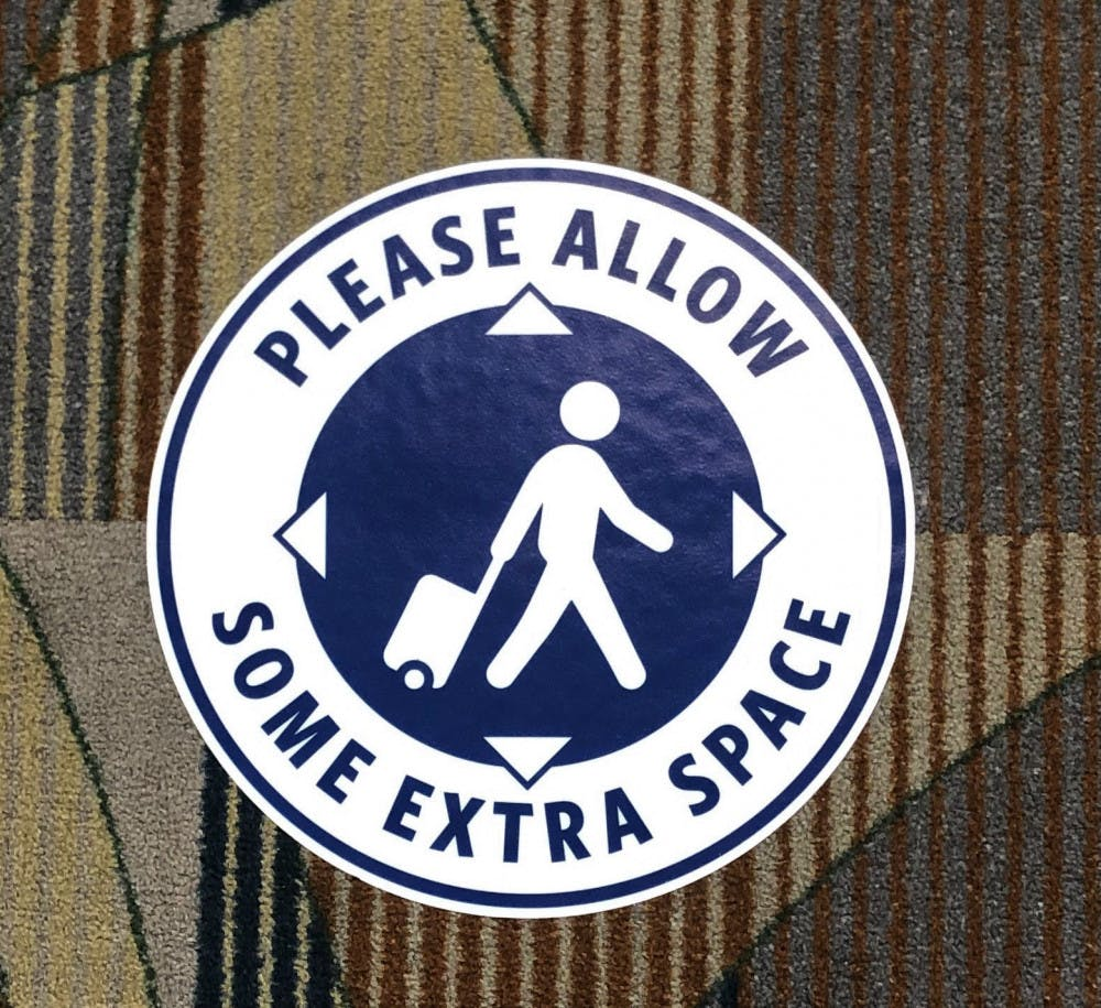 <p>A stick on the floor of the Gainesville Regional Airport promoting social distancing.</p>