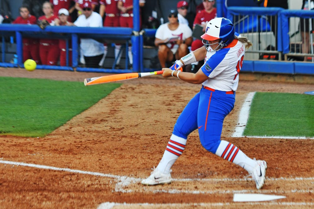 <p>Amanda Lorenz swings during Florida's 3-0 loss against Alabama in game one of the NCAA Super Regional on May 25, 2017, at Katie Seashole Pressly Stadium.</p>