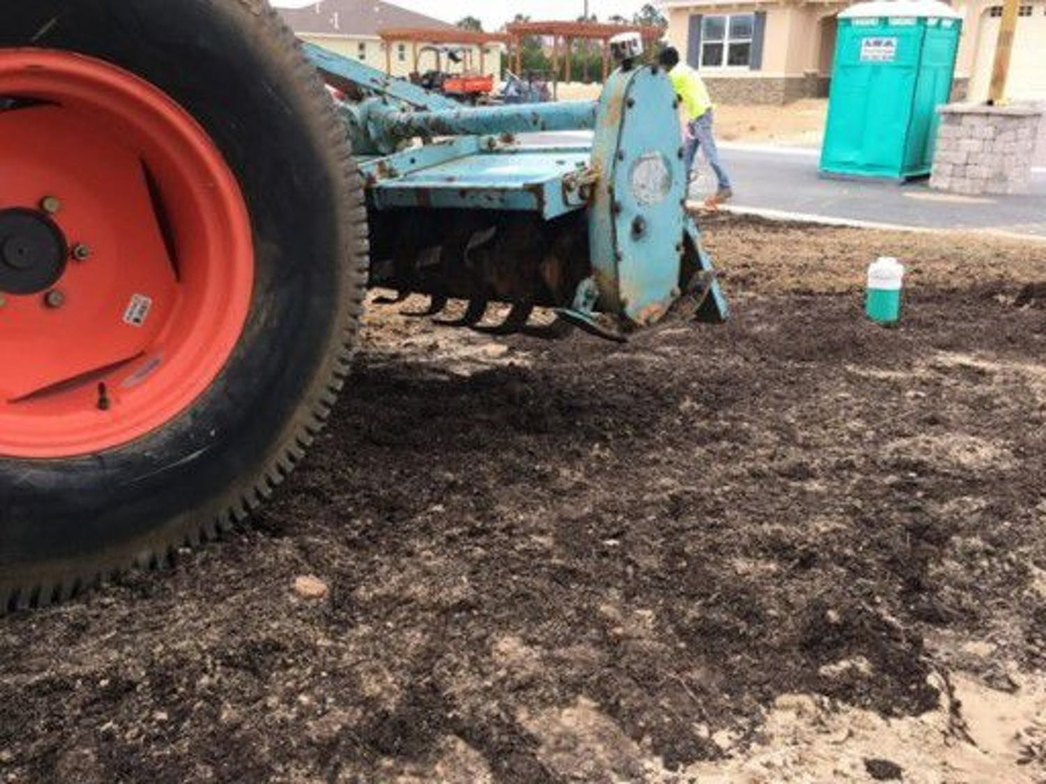 Researchers place compost on developing land plots. The team's first study is taking place at Ocala's On Top of the World retirement community.