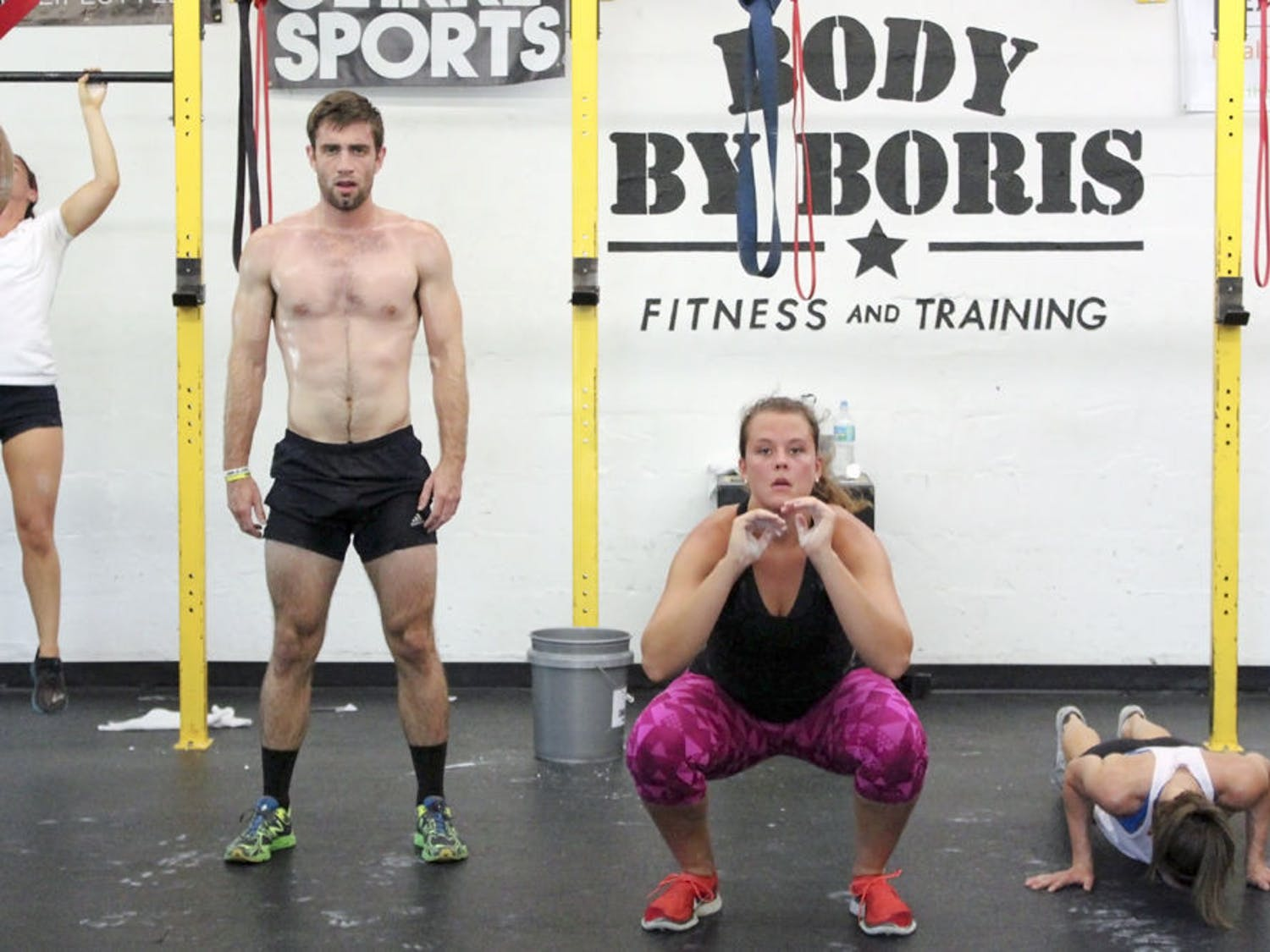 From left: Hunter Wyatt, 24, Samantha Mauder, 22, and Chloe Herring, 23, perform various exercises at the Memorial Day Murph event put on by Body By Boris, 1527 NW 6th St., on Monday. The event benefitted the Jonathan Cote Memorial Scholarships, which helps veteran UF and Santa Fe students pay for books and tuition.