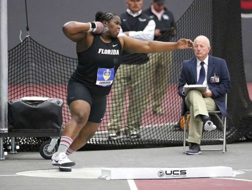 """<p dir=""""ltr""""><span><span><span>UF thrower Lloydricia Cameron throws the shot put during the&nbsp;</span></span>2016 SEC Indoor Track and Field Championships.&nbsp;</span></p> <p><span>&nbsp;</span></p>"""
