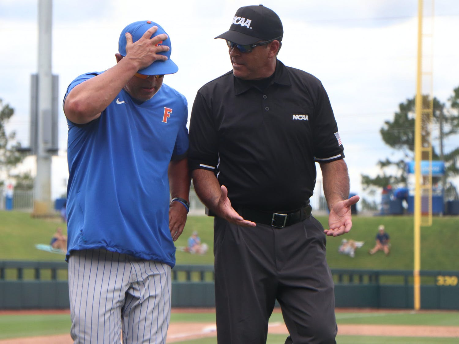 Florida baseball head coach Kevin O'Sullivan argues with an umpire after a waved-off ground ball in the sixth inning of a 19-1 loss to South Alabama on June 5. The loss ended the unanimous preseason No. 1's season at just 38-22 after being swept out of its own regional.