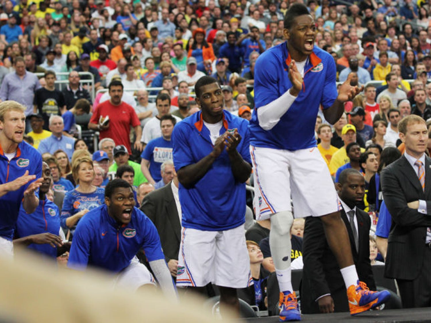 Will Yeguete (15) cheers for his teammates during Florida's 79-59 loss to Michigan on March 31 in Arlington, Texas.