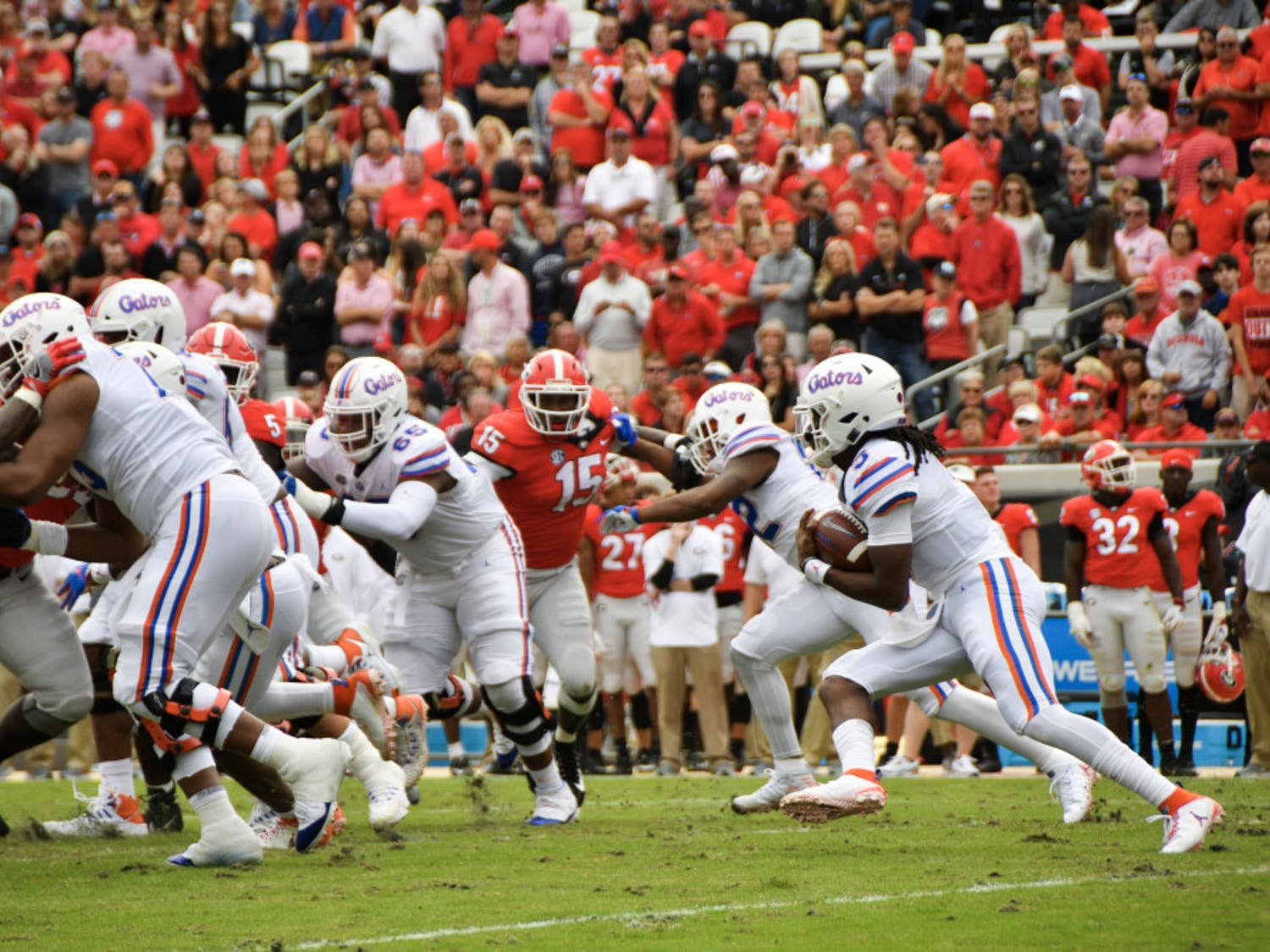Quarterback Emory Jones (right) has only two games of leeway remaining on his freshman redshirt.