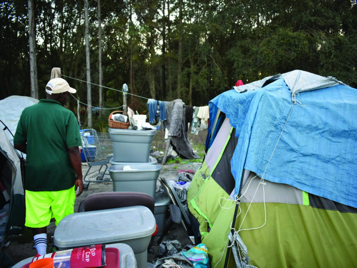 Rupert Heard, 55, gives a tour of his camp fit for three. As camp leader, he manages his group's finances and stocks up on daily supplies.