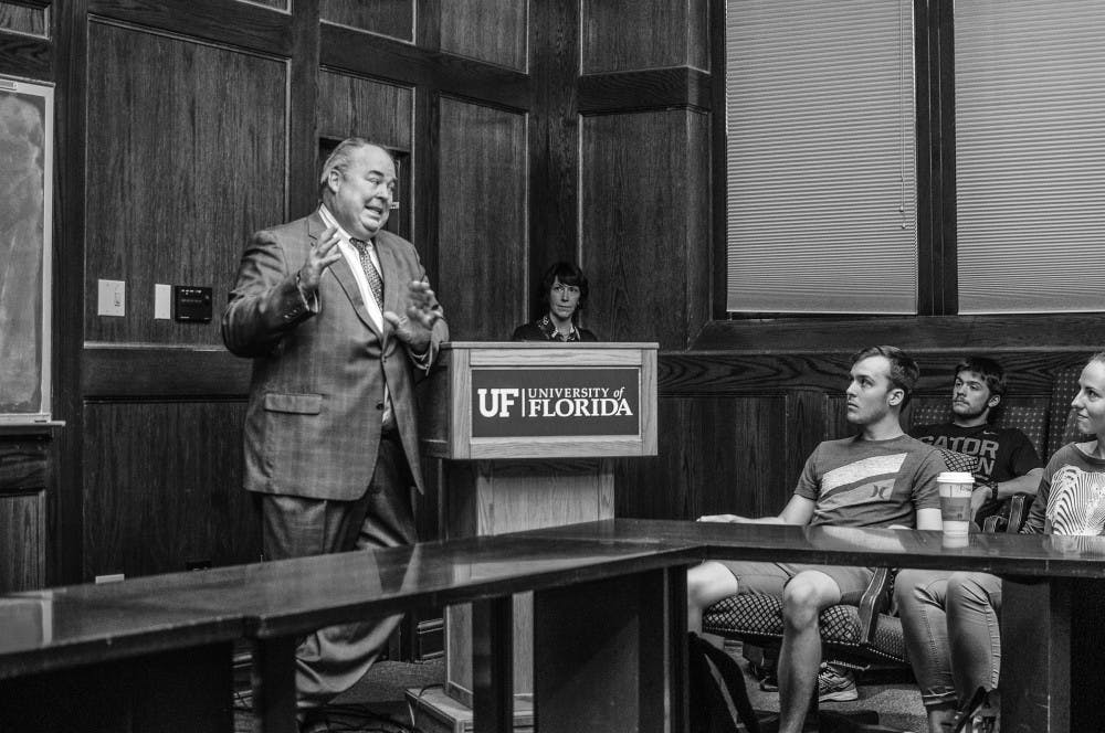 """<p><span id=""""docs-internal-guid-b716103b-1740-9684-75a7-1bb160cb9c55""""><span>UF alumnus and former Foreign Service Officer Carey Cavanaugh gives a speech to prospective U.S. State Department students on Monday. Alec Werthman, a 21-year-old UF biochemistry and molecular biology senior attending the talk, said he initially attended the lecture to satisfy a class requirement, but later realized it helped solidify his career choices.</span></span></p>"""