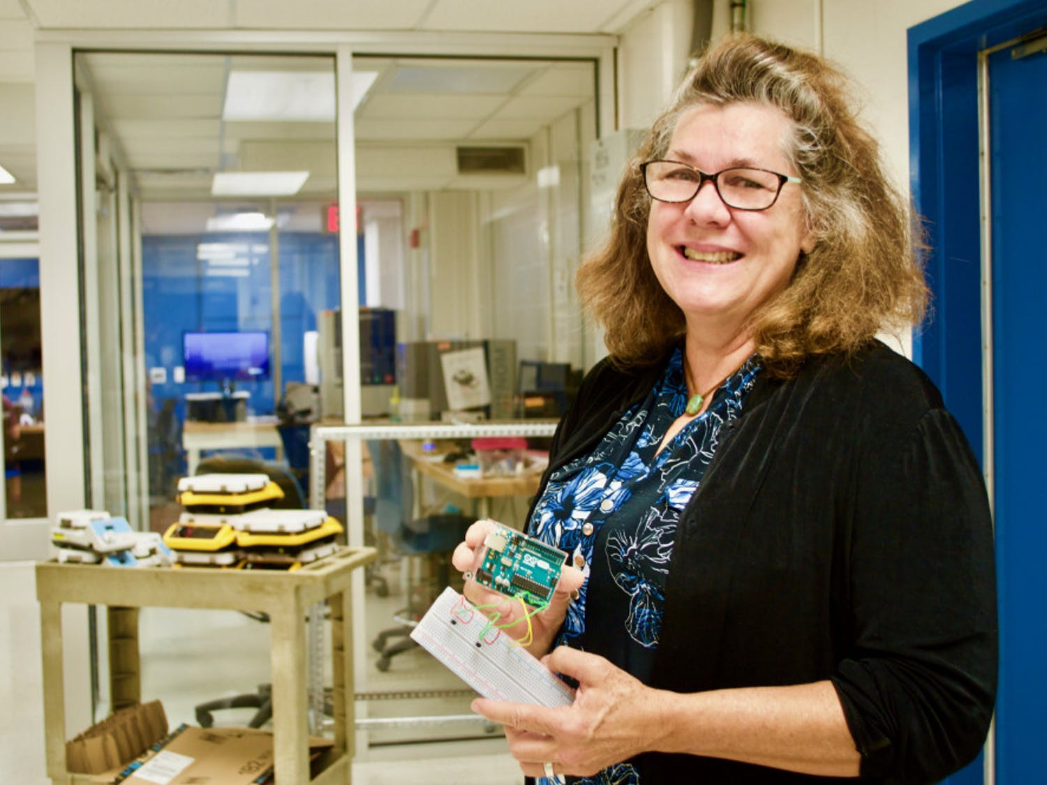 Nancy Ruzycki, a UF lecturer and the director of undergraduate laboratories at the Herbert Wertheim College of Engineering Department of Materials Science and Engineering, holds Arduinos, an type of open-source electronic, to create lab experiments involving data collection and analysis. Courtesy to The Alligator.