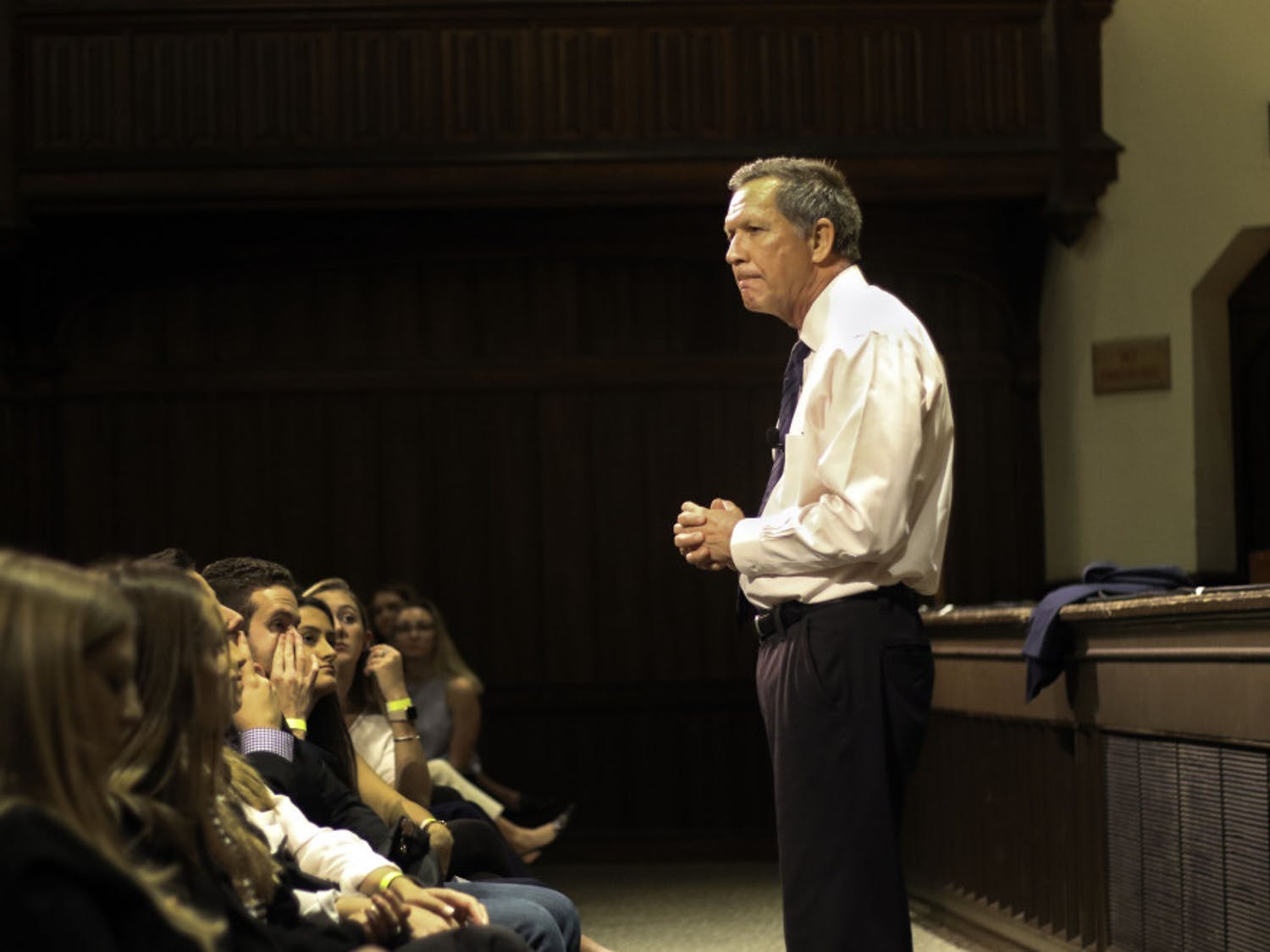 """John Kasich, former governor of Ohio and presidential candidate, speaks to around 800 people Wednesday in the University Auditorium at UF. Kasich spoke about lessons that he had learned throughout his life and encouraged students in the audience to try and impact the world in any way they can. """"Search for possibilities,"""" he said. """"Don't close your minds to what you can do."""" After the speech, he took questions from the audience."""