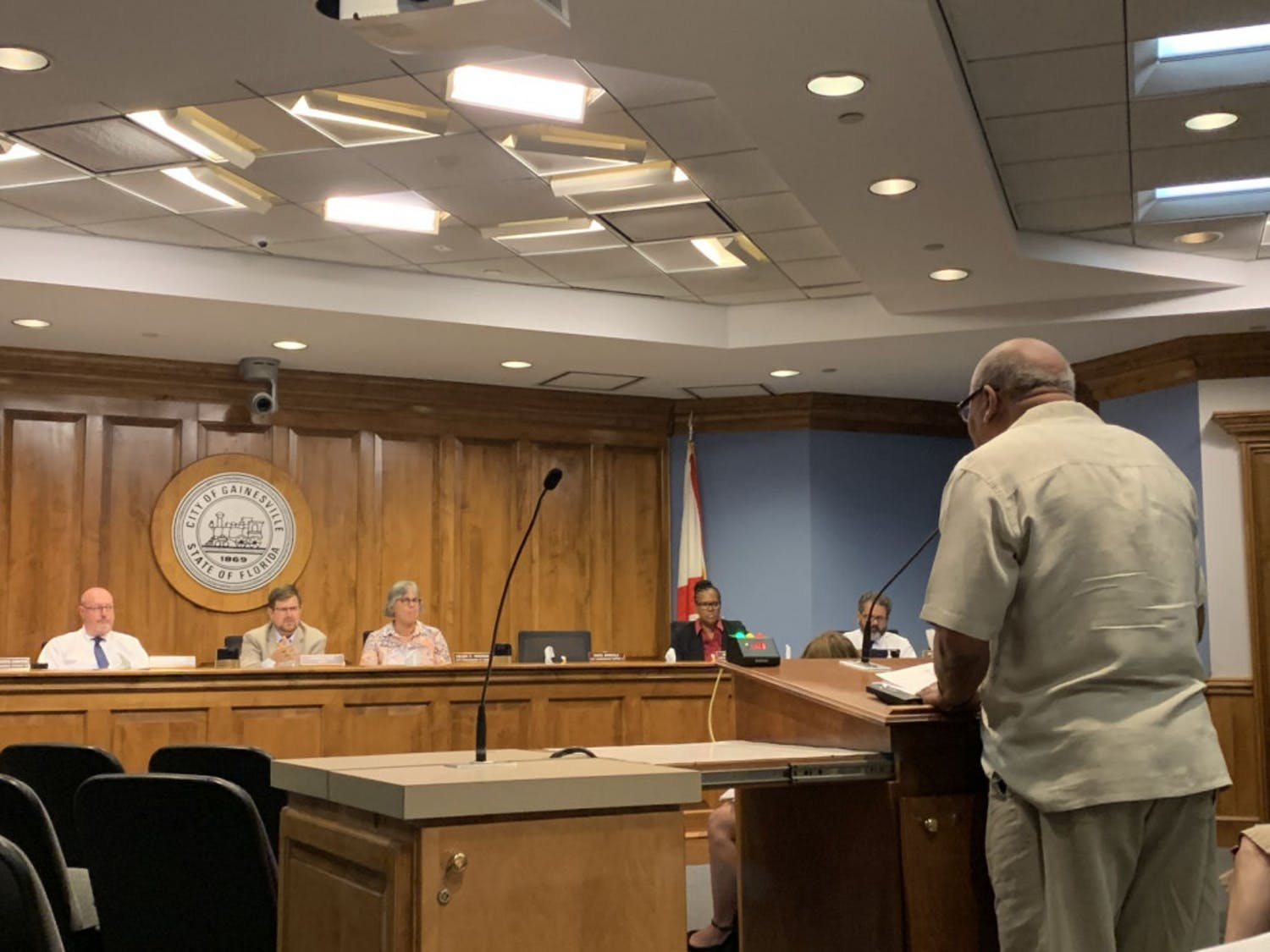 Aaron Green, a 73-year-old Gainesville resident, speaks to the city commission Thursday night about polystyrene cups and containers. Green said the discussions about possibly banning single-use plastics was affecting his business, Fletcher's Cocktail Lounge, which is located at 619 NW 5th Ave.