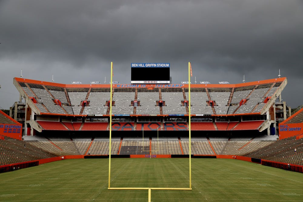 <p>An empty Ben Hill Griffin Stadium under an overcast sky. City Commissioner David Arreola wrote the UF Board of Trustees Monday, urging them to not allow fans at this year's home football games.</p>