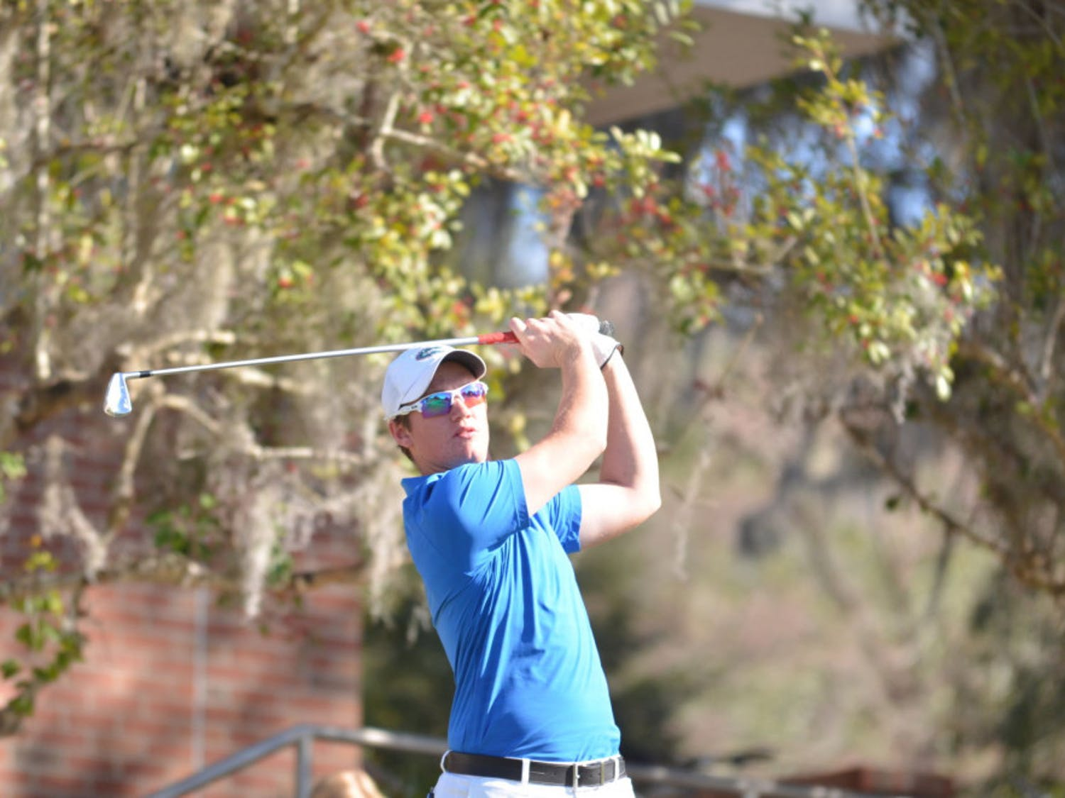 Sam Horsfield completes his follow-through during round two of the SunTrust Gator Invitational on Feb. 21, 2016 at the Mark Bostick Golf Course.