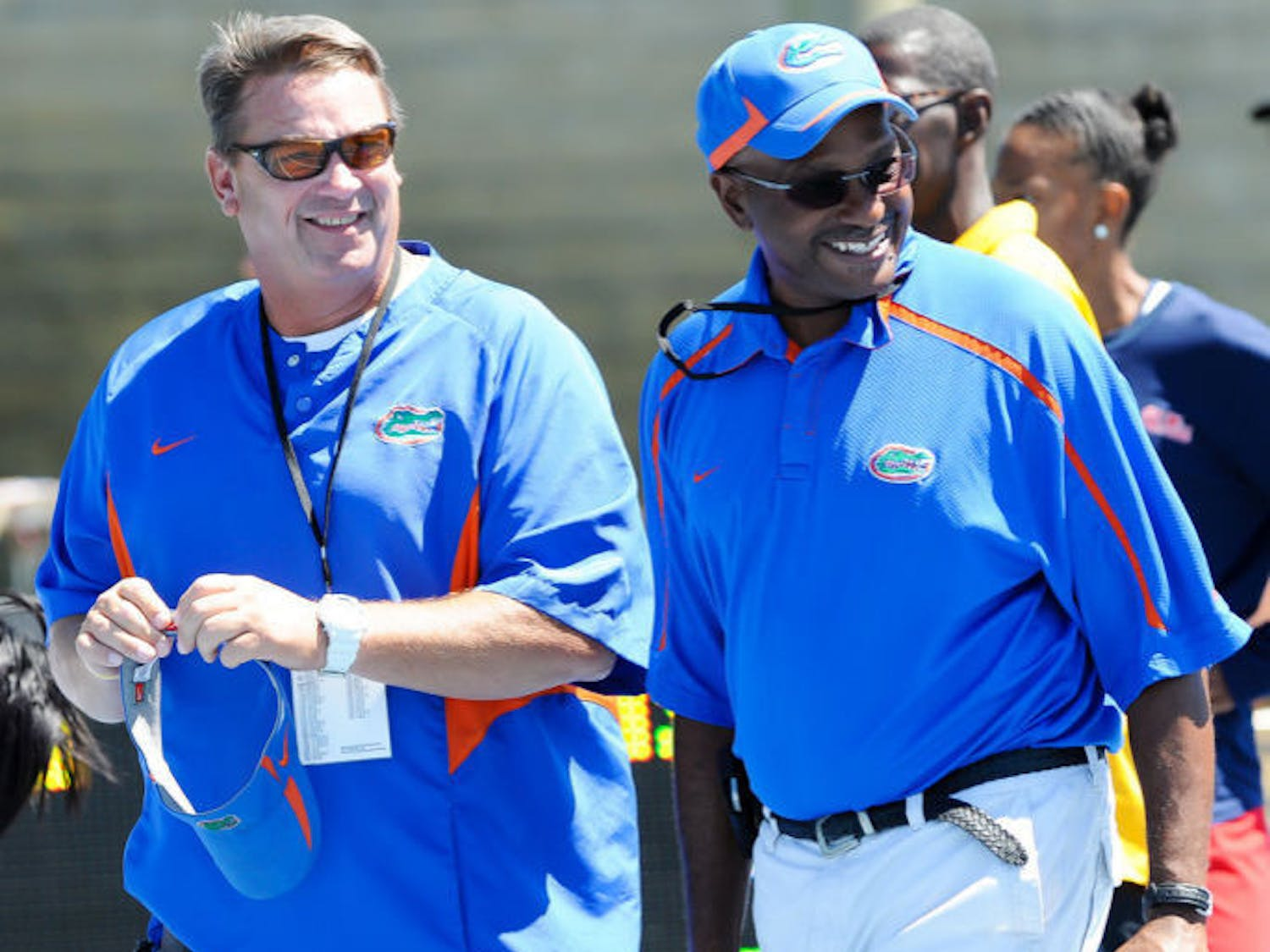 Throwers coach Steve Lemke (left) and coach Mike Holloway walk across the field at Percy Beard Track at Pressly Stadium during the 2012 Florida Relays. Seventeen Gators qualified Sunday for the NCAA Outdoor Championships, which are set to begin June 5.