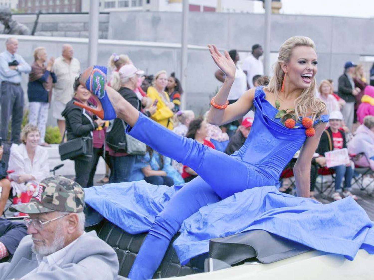 "Mary Katherine Fechel, 20, participates in the Show Me Your Shoes parade in Atlantic City Sept. 12, 2015, as a part of Miss America contestant traditions.Candidates wore shoes to represent their state. ""It was such a testament that the Gator nation is everywhere,"" Fechel said."