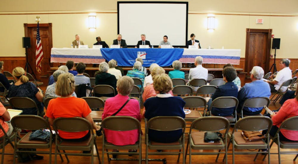 <p>City election candidates debate at the Alachua County League of Women Voters forum at the First United Methodist Church, located at 419 NE First St., on Saturday.</p>