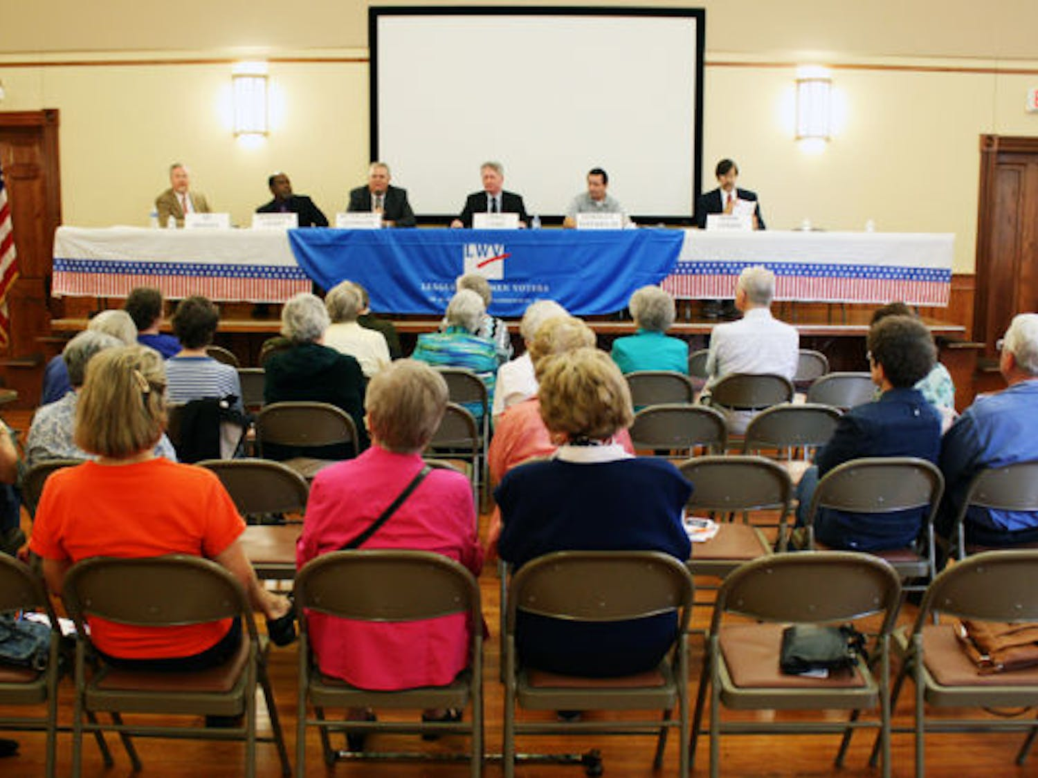 City election candidates debate at the Alachua County League of Women Voters forum at the First United Methodist Church, located at 419 NE First St., on Saturday.