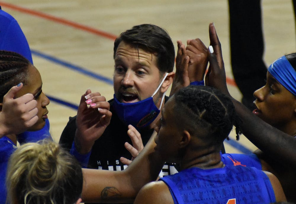 Former Florida coach Cam Newbauer in the huddle with his team in a game against Alabama on Feb. 18, 2021.