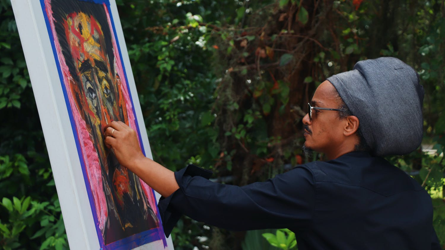 Prince Merid Tafesse of Ethiopia, 47, draws a live sketch of Haile Selassie, a former Ethiopian emperor, with pastels at the A. Quinn Jones Museum & Cultural Center on Saturday, Sept. 25, 2021. His exhibition is on display inside of the historic home-turned-museum.