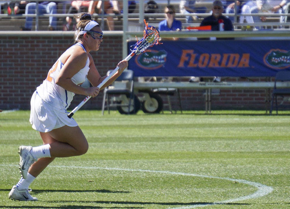 <p>Senior Taylor Bresnahan scored a hat trick for Florida in a dominant, 14-7 victory over Lousiville.</p>