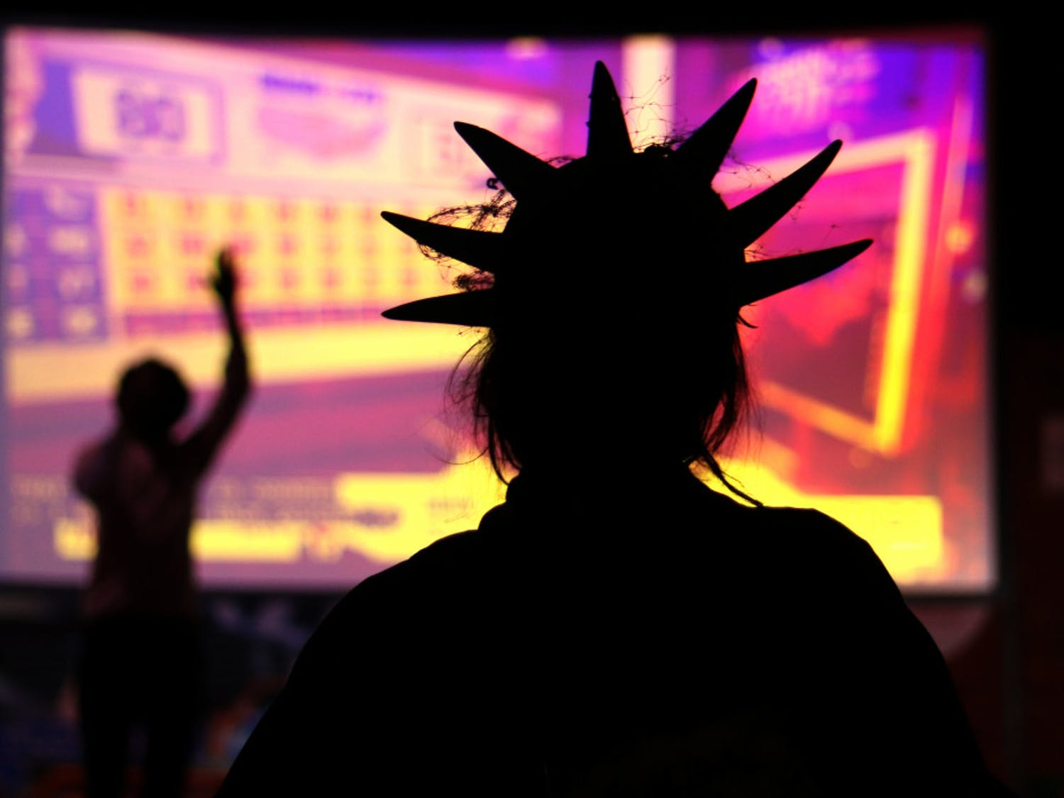 Avenlea Harris is seen dressed as the Statue of Liberty while watching the election results during the Bo Diddley Plaza watch party on Tuesday, Nov. 3, 2020. (Lauren Witte/Alligator Staff)