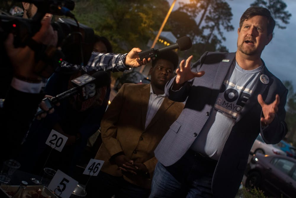 """<p dir=""""ltr""""><span>Lauren Poe speaks to a crowd of reporters and about 100 supporters March 20, 2019 at the Public and General restaurant after elections. Poe beat three opponents to win his second term as mayor of Gainesville.</span></p><p><span></span></p>"""