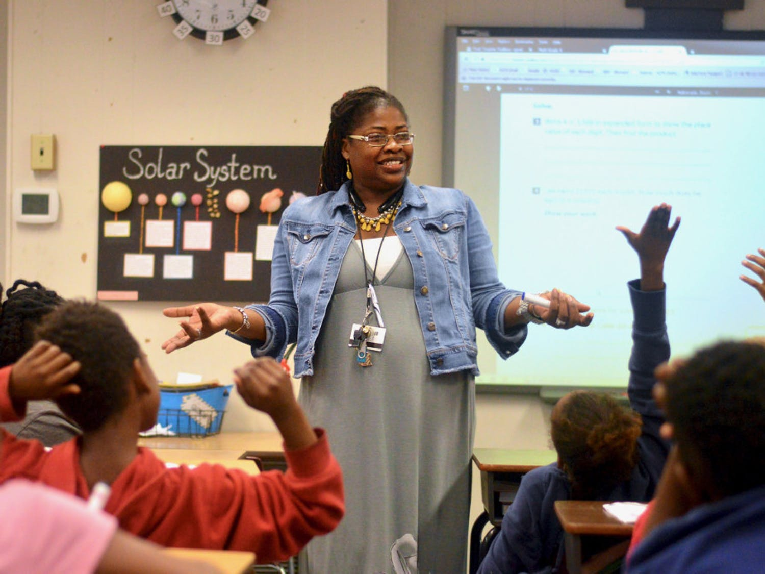 "[FILE PHOTO] 35-year-old Lilliemarie Gore leads students of Idylwild Elementary School through a series of math exercises. Mrs. Gore was awarded the title of ""2017-2018 Alachua County Teacher of the Year"" earlier this month."