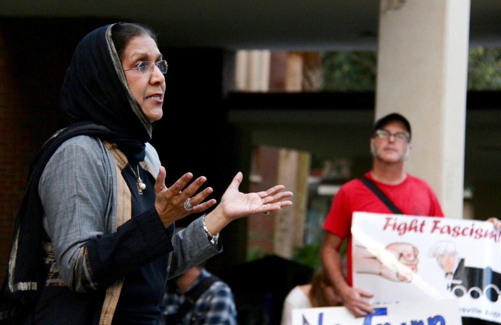 """<p dir=""""ltr"""">Indian-American immigrant Aqueela Khuddus, 63, explains to a group of about 30 people how welcoming Americans were when she emigrated to the U.S. about 50 years ago. The director of a nonprofit organization, the Khadija Foundation, was one of five speakers at the Rally Against Fascism and Xenophobia held on the Plaza of the Americas on Monday night.</p>"""