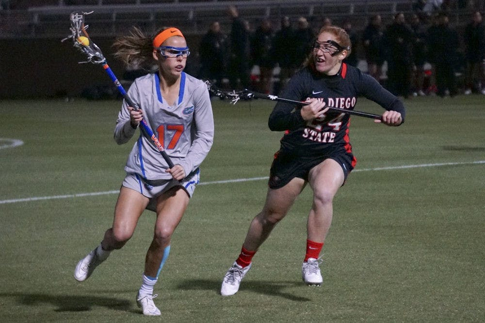 <p>Mollie Stevens (17) runs toward the net during Florida's win against San Diego State last season at Donald R. Dizney Stadium.</p>