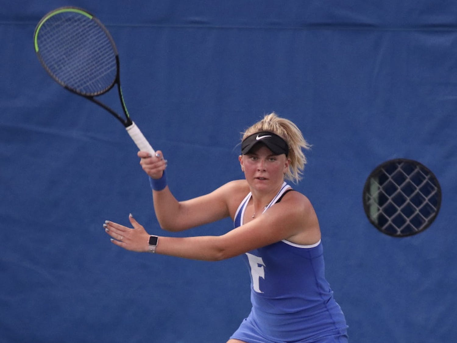 Freshman Sara Dahlstrom prepares for a forehand return against LSU Feb. 26