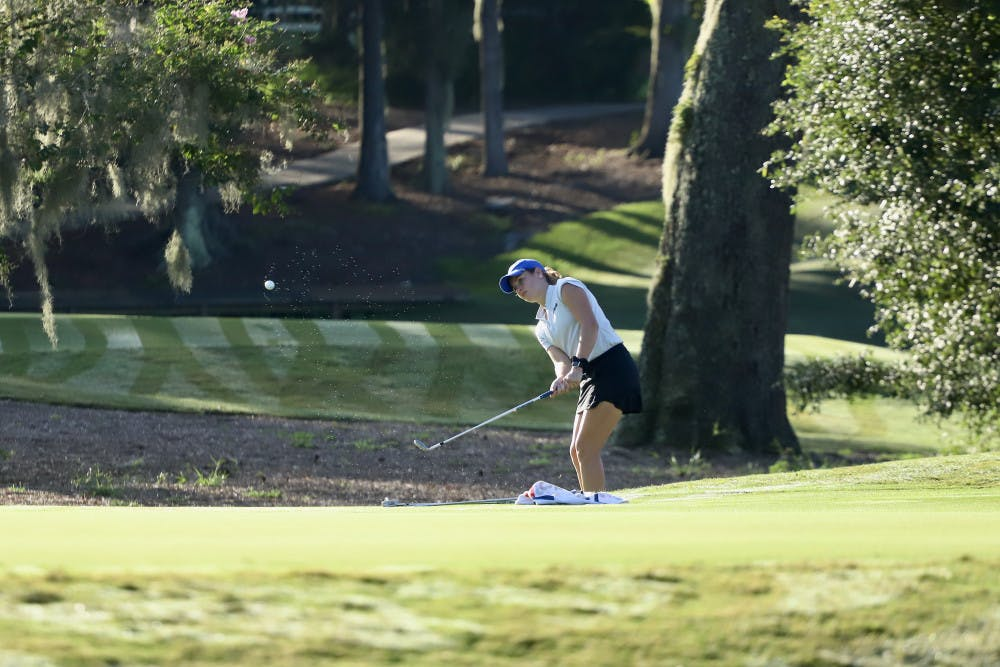 <p>Senior Lauren Waidner hits a ball up into the air at Mark Bostick Golf Course. She was awarded with the East Lake Foundation's Tom Cousins Award.</p>