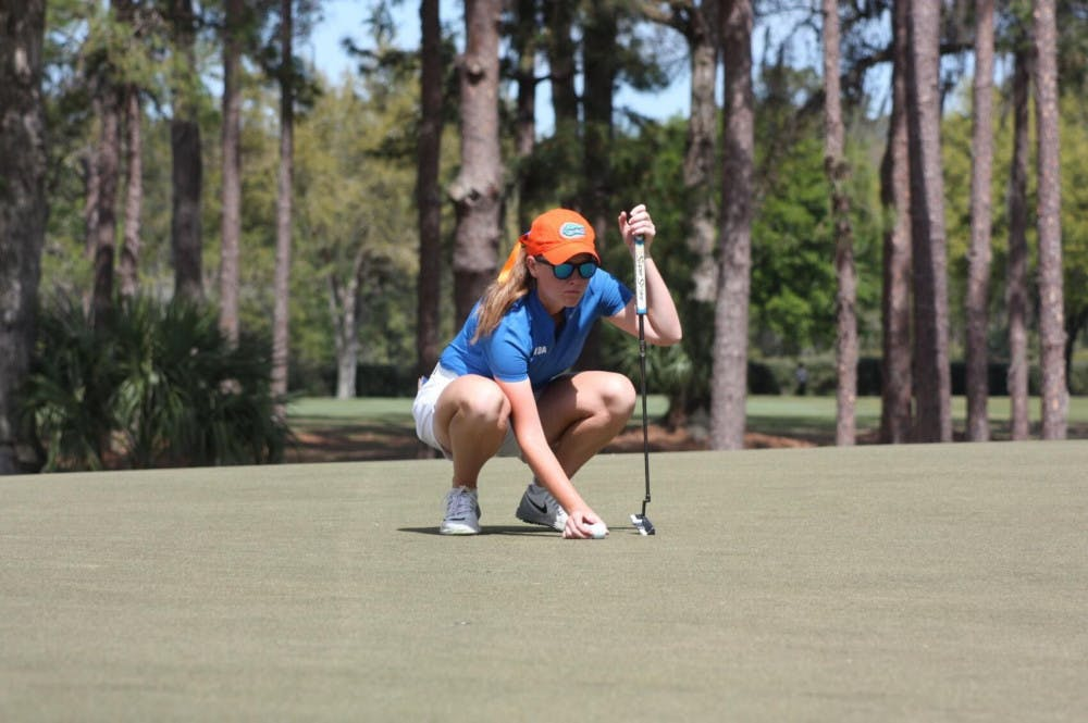 "<p>Junior Addie Baggarly kneels down to contemplate a putt. Her teammate&nbsp;<span id=""docs-internal-guid-d7114a3f-7fff-43d5-51c7-1dcec9e30133""><span>Annabell Fuller came in second at the Amateur&nbsp;Women's Championship this past weekend.</span></span></p>"