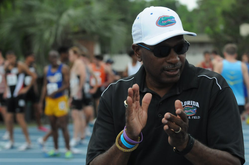 <p>Coach Mike Holloway claps as he watches his team.</p>