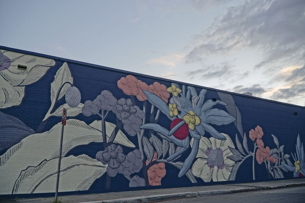 <p>A mural in the 352Walls Project decorates the north wall of The Top, facing Northwest First Avenue, on Dec. 3, 2015.</p>