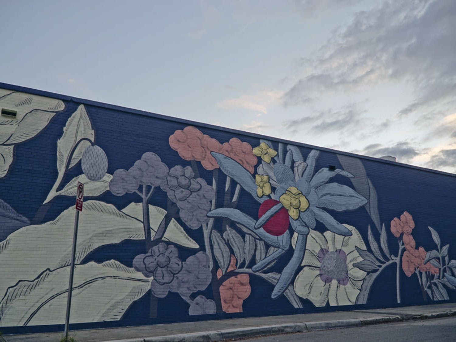 A mural in the 352Walls Project decorates the north wall of The Top, facing Northwest First Avenue, on Dec. 3, 2015.