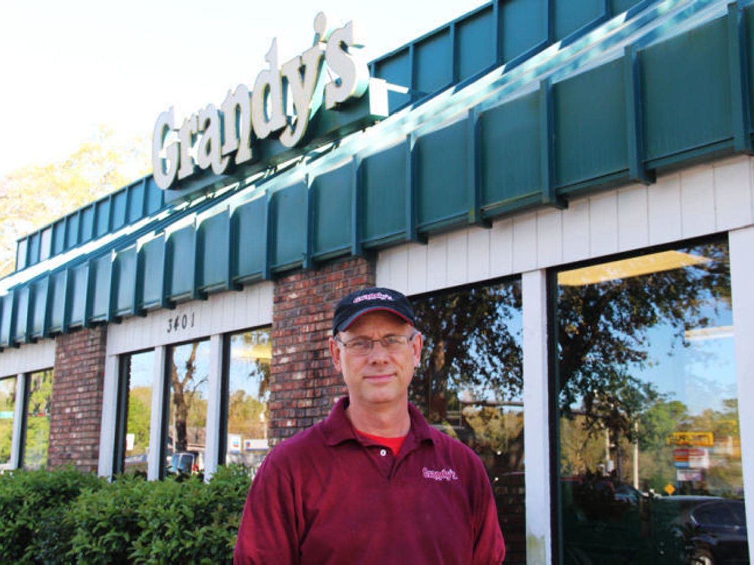 Grandy's franchise owner Dave Miles stands in front his restaurant on the corner of West University Avenue and Southwest 34th Street on Thursday.