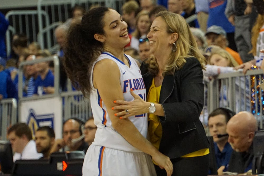 <p>Coach Amanda Butler (right) celebrates with Eleanna Christinaki during Florida's win over Kentucky on Jan. 31, 2016, in the O'Connell Center.</p>