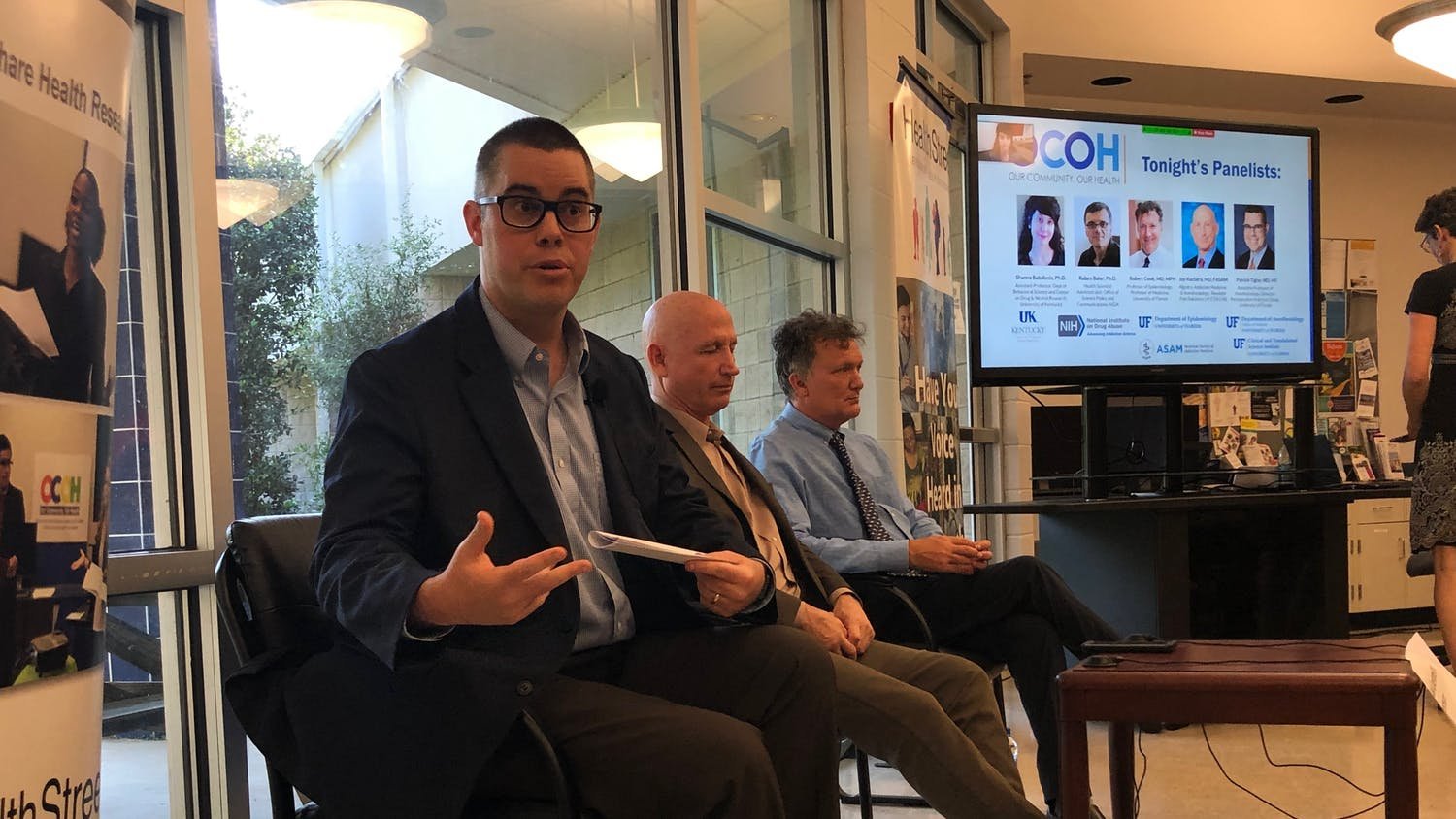 Patrick Tighe (left), a UF associate professor of anesthesiology starts off the Town Hall Medical Marijuana at UF HealthStreet.He sits alongside two other panelist, Jay Kuchera (middle), a board-certified anesthesiologist and Robert Cook (right), UF Epidemiology Professor.