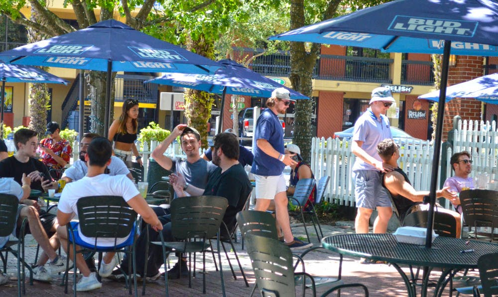 <p>People gather at The Swamp Restaurant May 5, one day afterGov. Ron Desantis began to re-open the state economy.</p>
