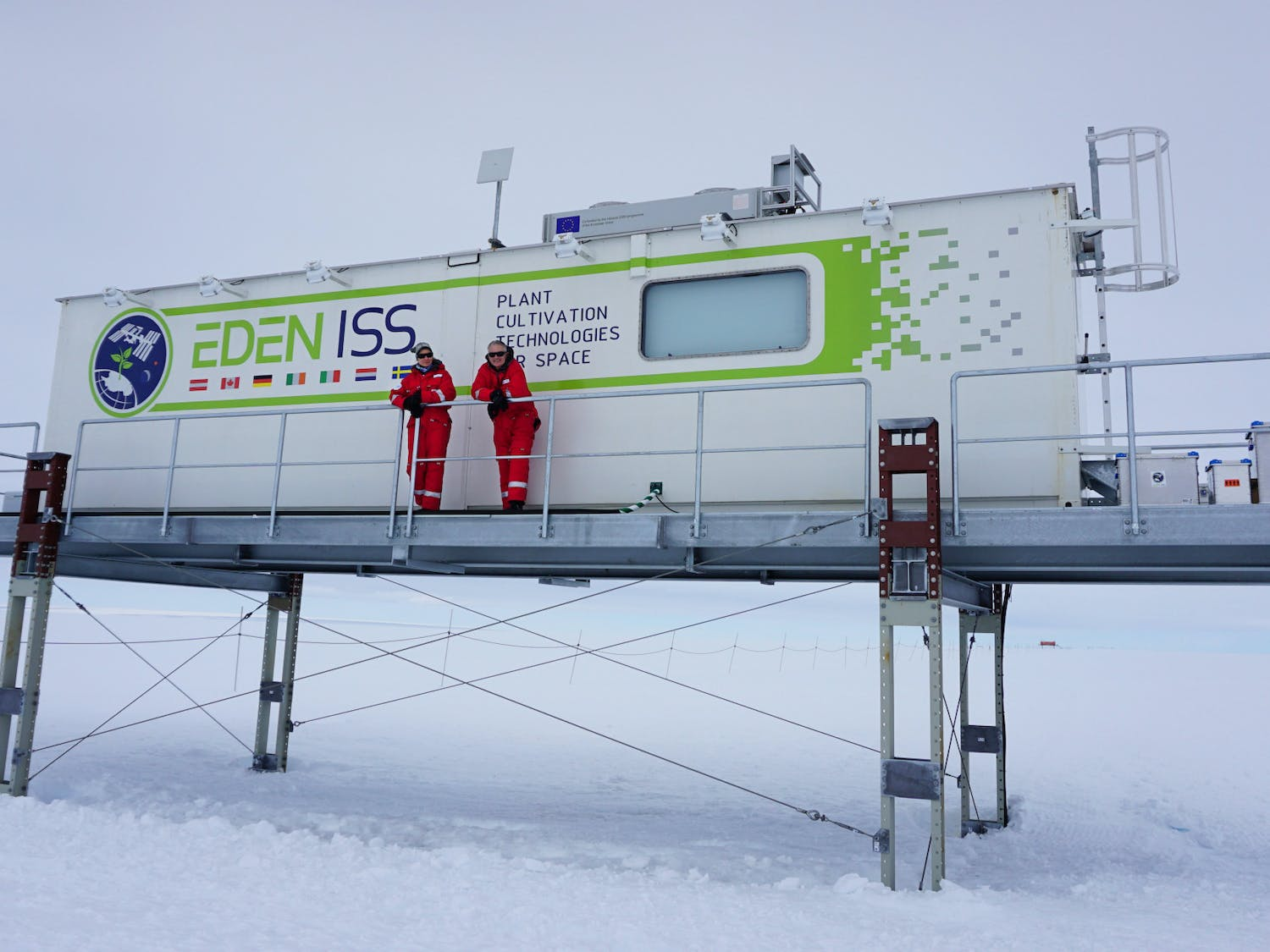 Anna-Lisa Paul (left) and Robert Ferl, (right) the principal investigators of the UF space plants lab, stand outside of the EDEN ISS greenhouse in Antarctica where plants are cultivated in extreme conditions with the goal of learning how to successfully grow plants in space.