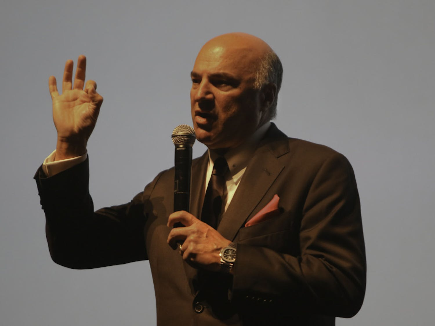 "Kevin O'Leary, the 64-year-old businessman and star of the television show ""Shark Tank,"" speaks Monday to a packed auditorium at the Phillips Center for the Performing Arts at UF. O'Leary used clips from the television show during the presentation and took questions from the audience at the end."