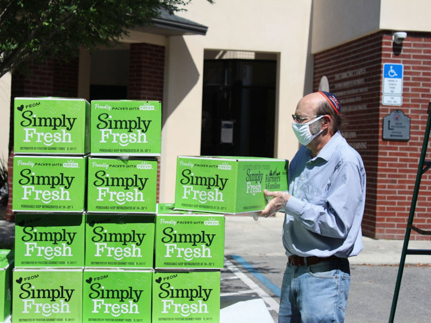 Steven Slutsky, a University of Florida professor of economics, volunteered as part of the effort to distribute boxes of food. Slutsky has volunteered at other initiatives the Lubavitch Chabad Jewish Center of Gainesville has undertaken, like when they gave away 50,000 masks.