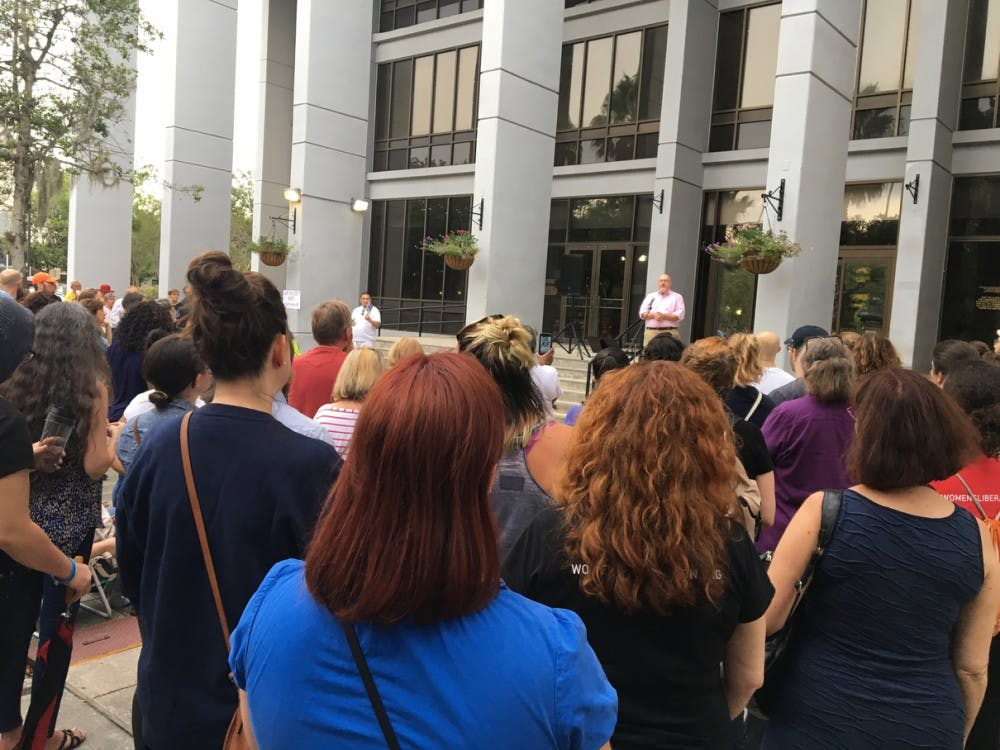 """<p><span id=""""docs-internal-guid-324f55b5-dea1-bbb4-73da-e74630b0303f""""><span>More than 300 people gather outside Gainesville City Hall to listen to Commissioner Harvey Ward Jr. speak about the Charlottesville, Virginia white supremacy rally and encourage people to get involved with their community.</span></span></p>"""