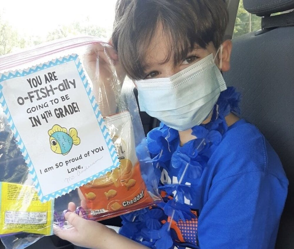 """<p dir=""""ltr""""><span>Rising Stephen Foster Elementary School fourth grader Cassius Goldman holds a congratulatory piece of """"miss you mail"""" from his third grade teacher, Stephanie Anderson.</span></p> <p><span>&nbsp;</span></p>"""