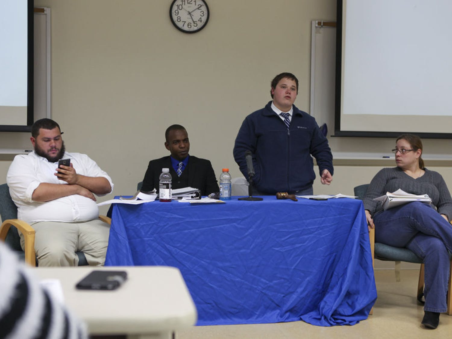 From left, SFC SG parliamentarian Andy Alvarez, Student Senate President Jeremy Pierce, Senate Pro Tempore Dalton King and Senate Secretary Kelly Cooper preside over Pierce's impeachment along with other issues, at the SFC Student Senate meeting Wednesday.