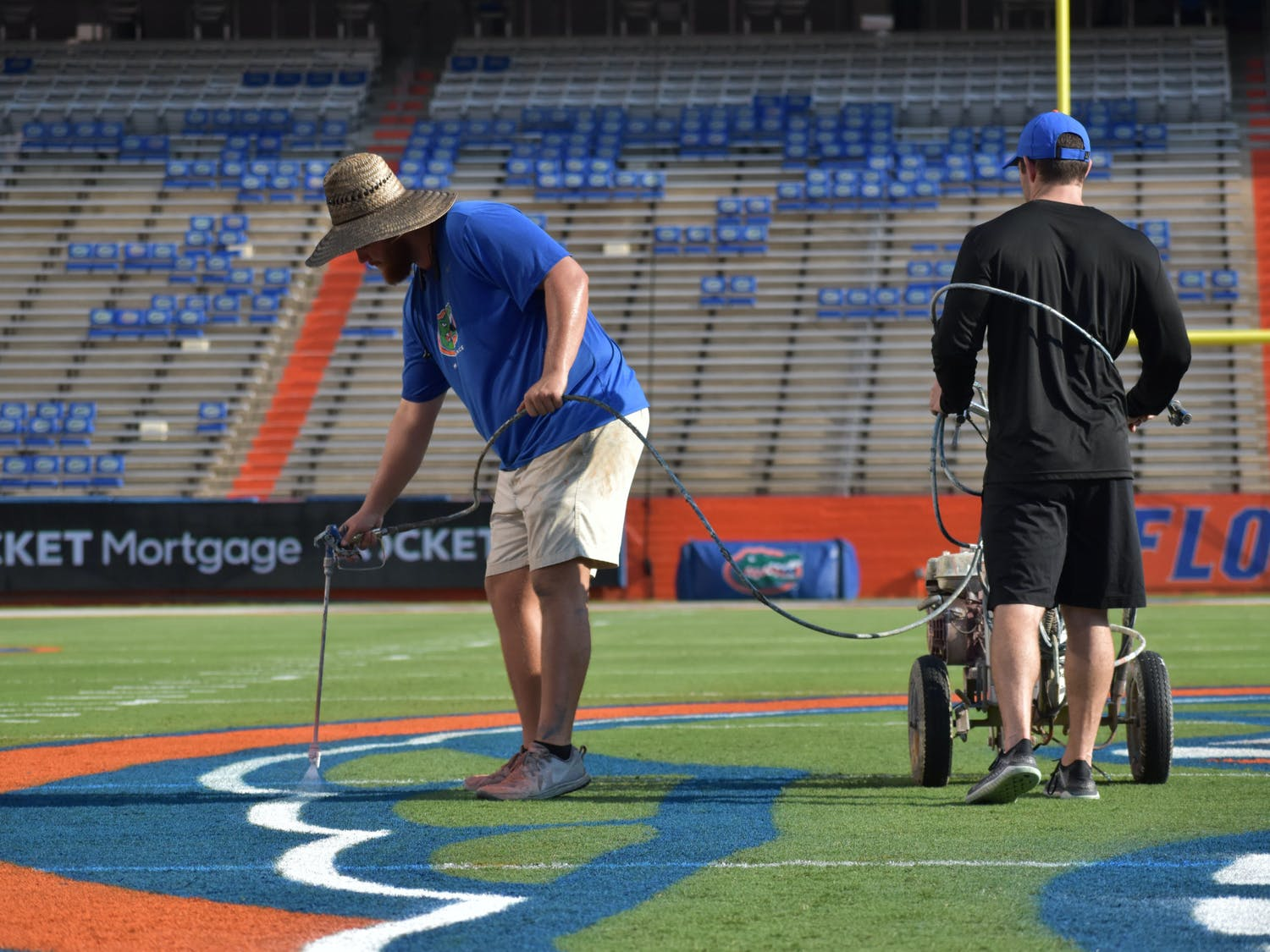 Field maintenance staff add the final touches to the Steve Spurrier-Florida Field in preparation for game day on Friday, Sept. 3, 2021.