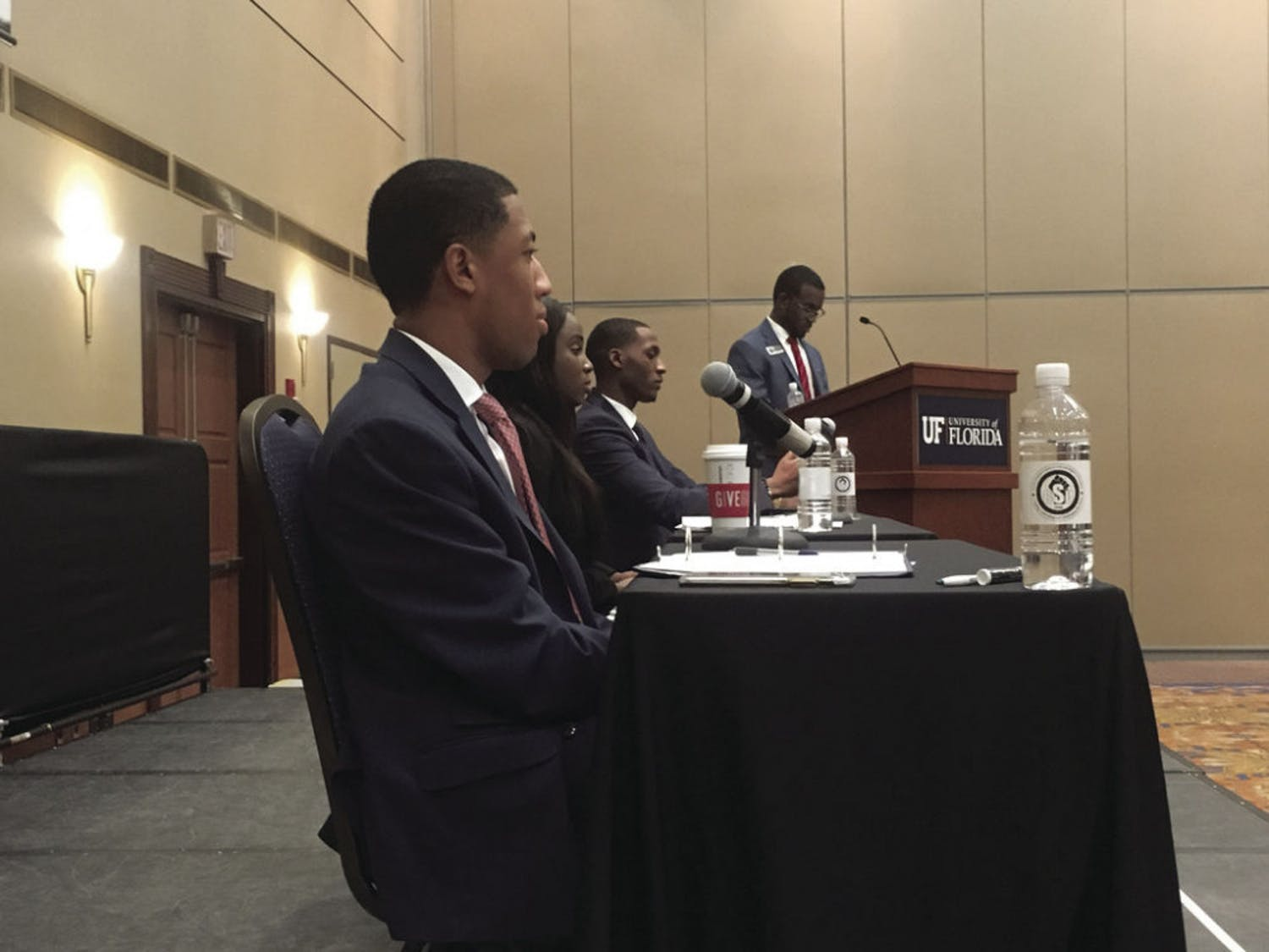 Student Body President candidates Ian Green, Janae Moodie and Revel Lubin answer audience questions at the Black Student Union debate. This is the first time in UF history three black students have run for Student Body president.