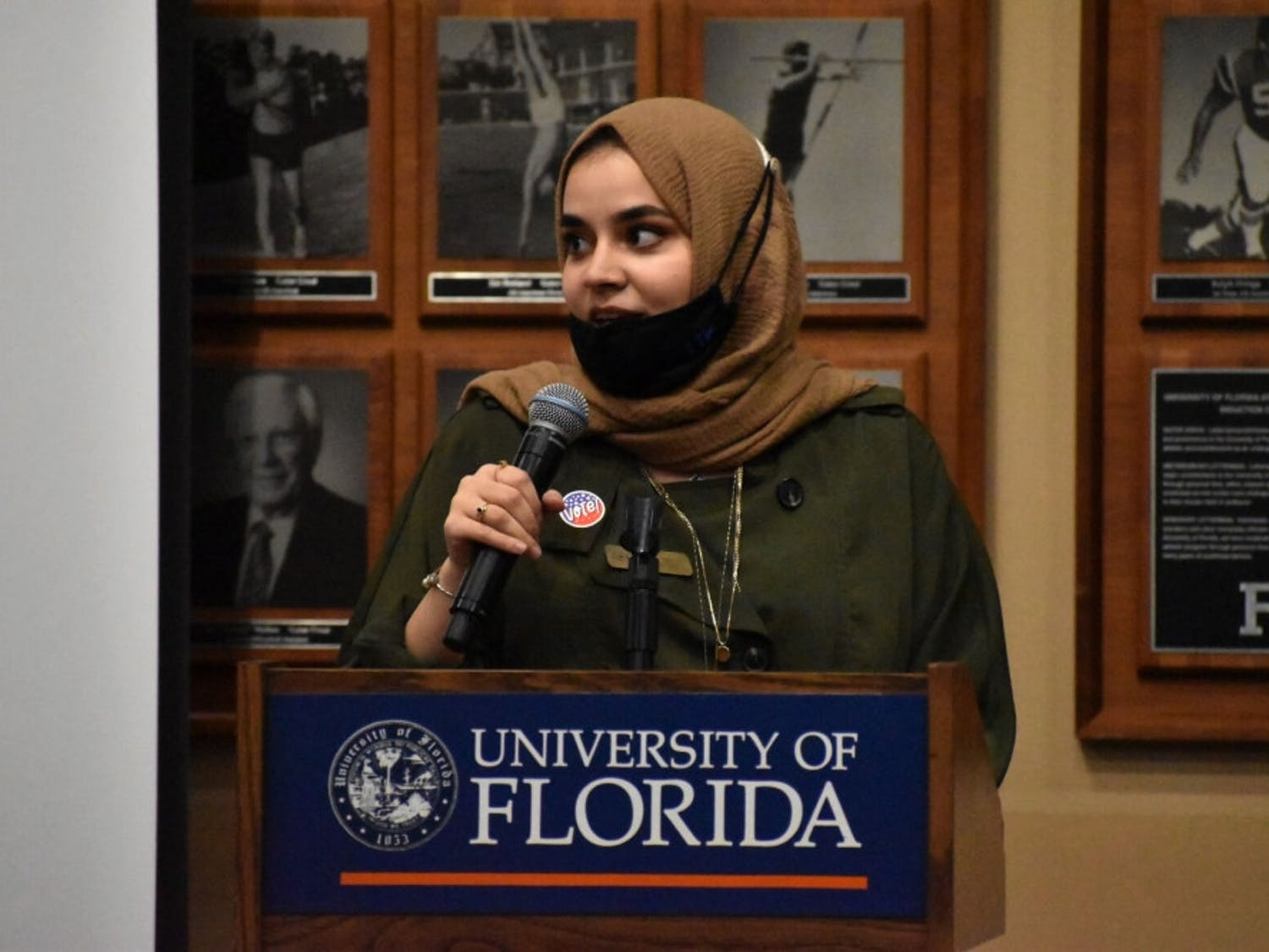 Mona Samsam, 22, a UF chemical engineering senior, and president of Islam on Campus, reminds attendees to vote in the upcoming November election, during political activist Linda Sarsour's speaking event at the Touchdown Terrace on Tuesday, Oct. 27, 2020.